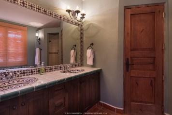 Each bedroom has a bathroom with twin sinks. Behind the door is the toilet.