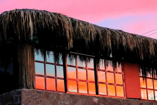 A beautiful sunset reflecting off the front windows of Mike's bar.