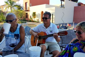 """Pedro hosts a """"Fat Tuesday"""" happy hour outside his deli in Agua Viva and might even entertain."""