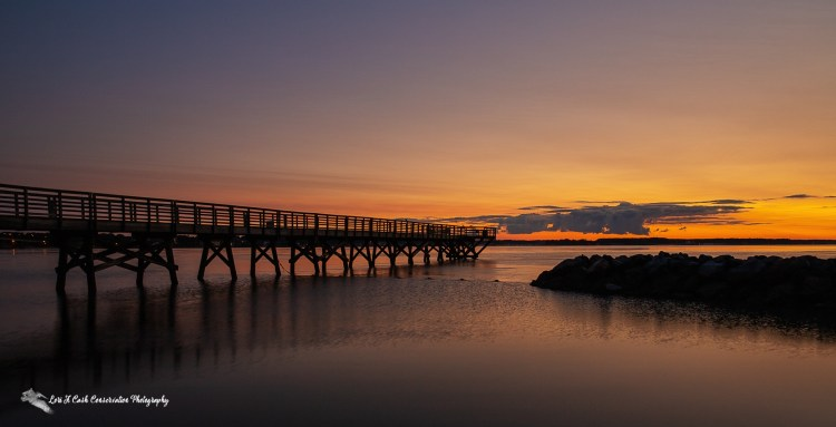 Summer sunrise on the York River from the view of the beach in Yorktown, Virginia.