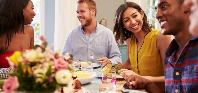 This woman is enjoying life with her friends at a dinner party since curcumin relieved her depression symptoms