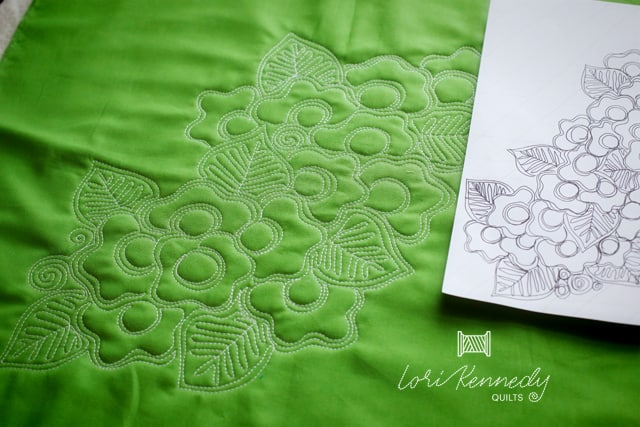 Gorgeous floral quilt motif on green fabric