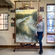 "Lori McNee in her Sun Valley studio with""Last Light"" 60x40oil on canvas"