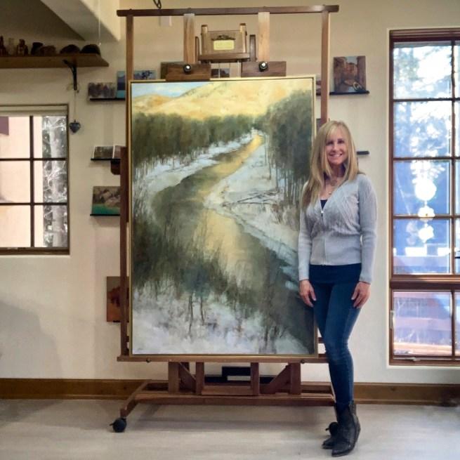 "Lori McNee in her Sun Valley studio with""Last Light"" 60x40oil on canvas"