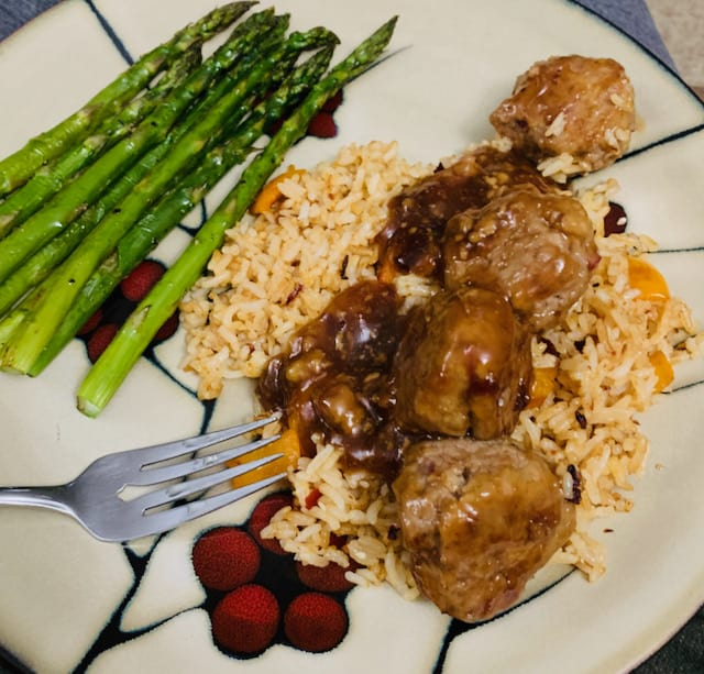Sweet & sour meatballs, spicy sesame coconut rice and asparagus.