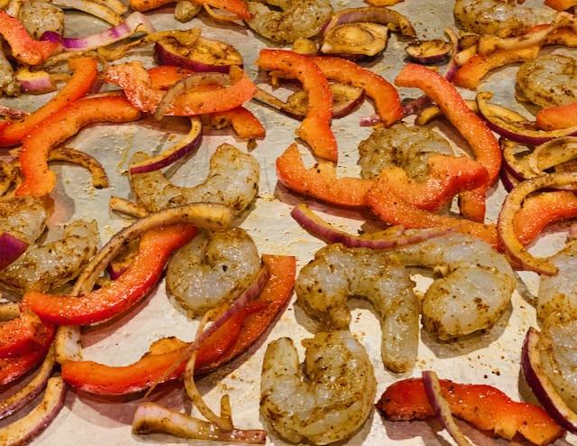sheet pan shrimp fajitas before baking