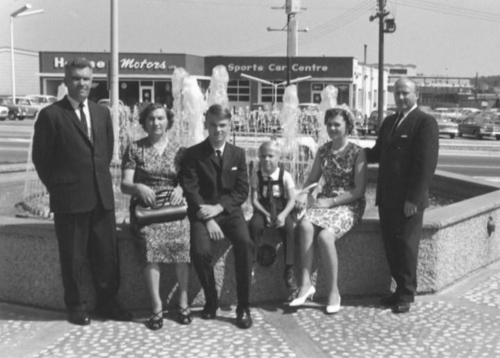 Heffner & Zimmermann families, circa 1965, in Rockway Gardens, Kitchener. Heffner Motors is in the background.