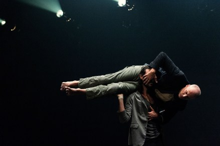 Two men in a contemporary dance piece called Dancers of Parts + Labour_Danse.