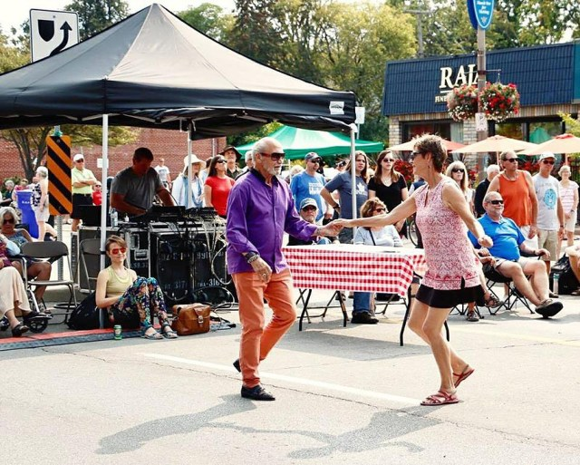 And older couple dancing while others look on, at Bestival in Belmont Village, Kitchener, Ontario. Photo by Andrea Deering.