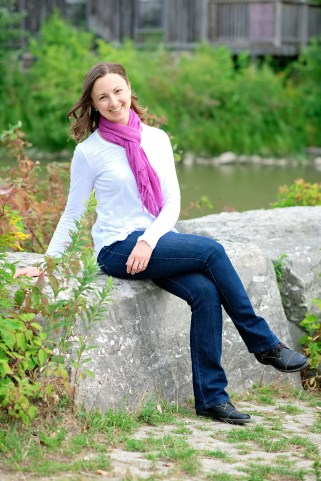 Canadian author Lori Wolf-Heffner sitting on a rock