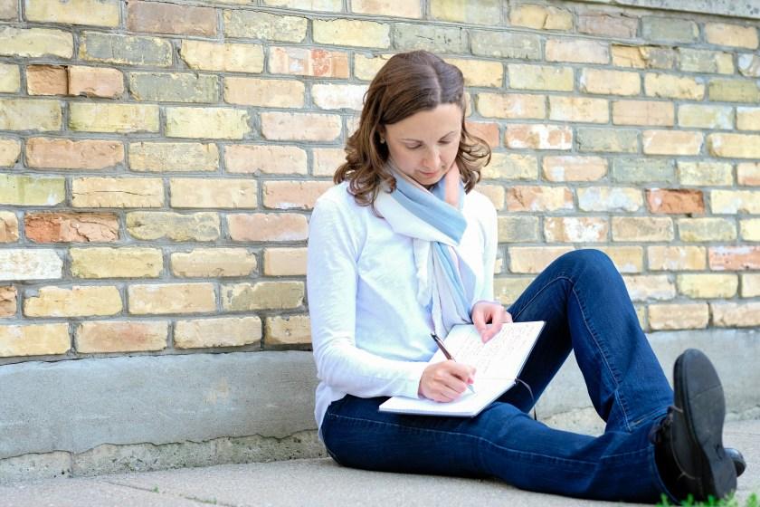 Author Lori Wolf-Heffner writing in her journal