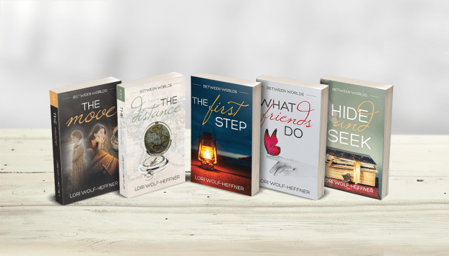 "Line-up of all five books from Lori Wolf-Heffner's series, ""Between Worlds."""