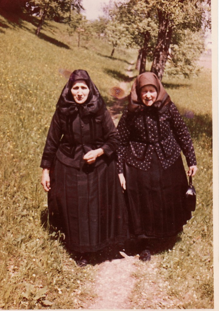 Two women from Schoendorf, Romania, dressed all in black, their traditional Sunday clothes.