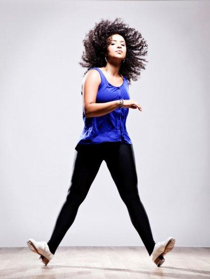 Full body shot of tap dancer Lisa LaTouche tapping