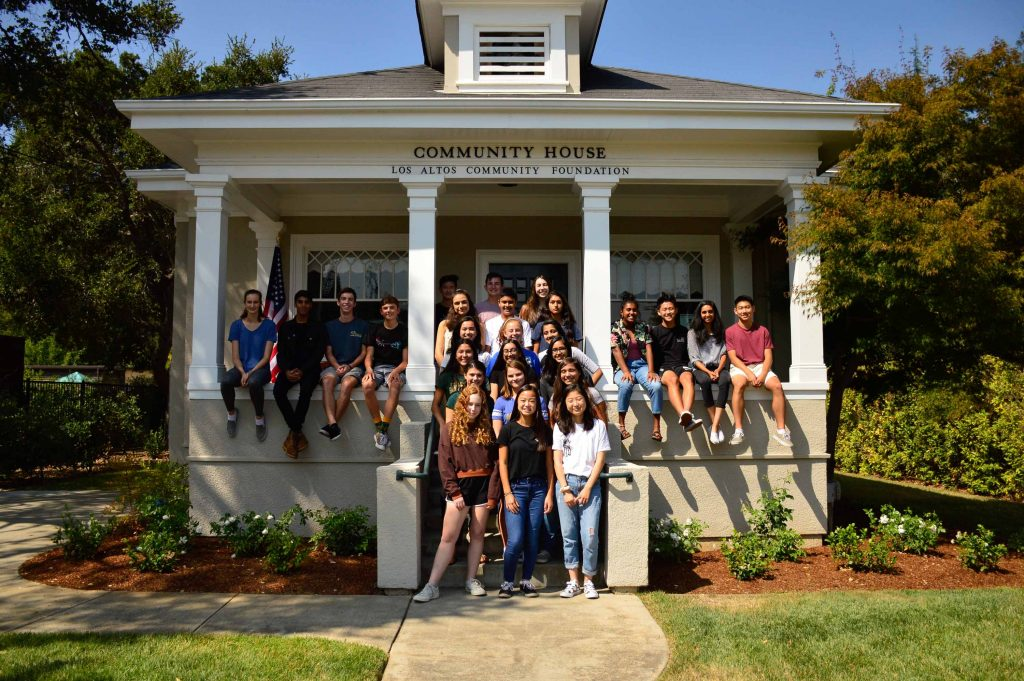 e3 kids in front of community house
