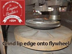 Grind lip angle edge onto flywheel