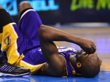 Image courtesy of re-crazy.com - Bryant lying on the ground after suffering a fracture of the lateral tibial plateau in the left knee during a win over the Memphis Grizzlies