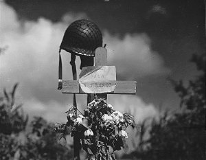 French civilians erected this silent tribute to an American solider who has fallen in the crusade to liberate France from Nazi domination. Carentan, France., 06/17/1944