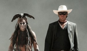 """THE LONE RANGER"" L to R: Johnny Depp as Tonto and Armie Hammer as The Lone Ranger Ph: Peter Mountain ©Disney Enterprises, Inc. and Jerry Bruckheimer Inc. All Rights Reserved."