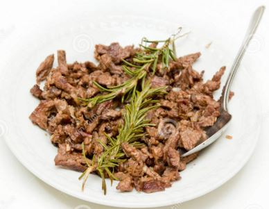 Tibs. A thinly sliced ox meat with onions, garlic and a ton of oil.