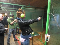 Asia shooting accurately with a light gun.