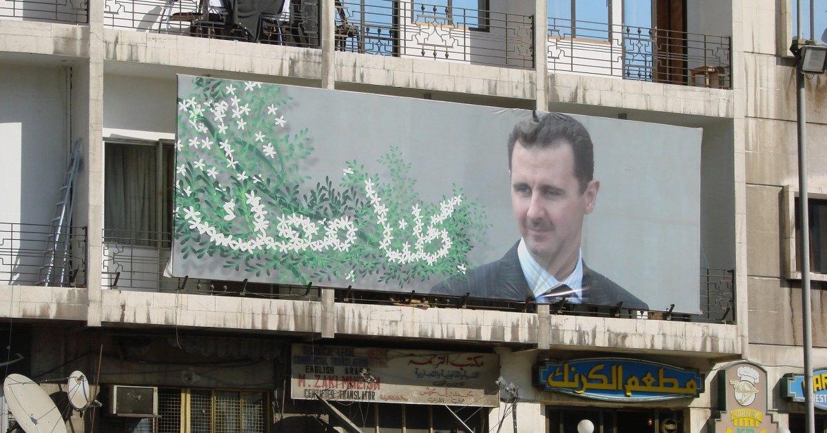 Un poster della propaganda di Bashar al-Assad