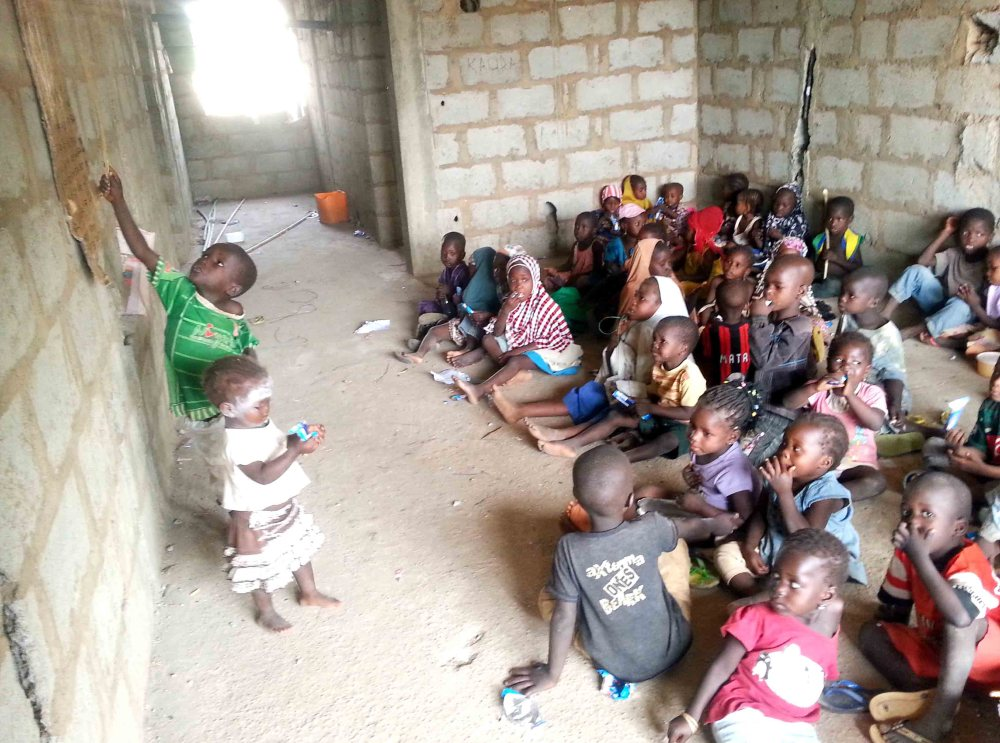 PIC.-4.-CHILDREN-HOLDING-A-CLASS-SESSION-AT-IDPS-CAMP-IN-ABUJA.jpg