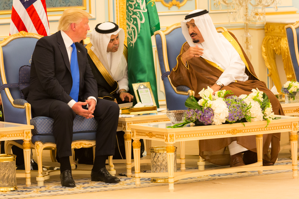 Donald_Trump_and_King_Salman_bin_Abdulaziz_Al_Saud_talk_together,_May_2017