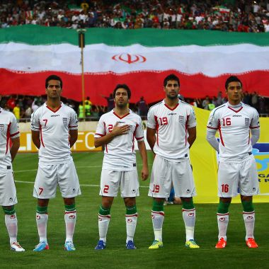 TEHRAN, IRAN - JUNE 11: Iranian team line up for national anthems during the FIFA World Cup Asian Qualifier between Iran and Lebanon at Azadi Stadium on June 11, 2013 in Tehran, Iran.