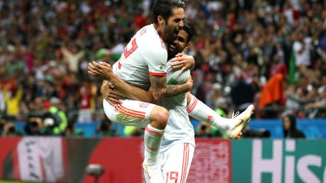KAZAN, RUSSIA - JUNE 20: Diego Costa of Spain celebrates with teammate Isco after scoring his team's first goal during the 2018 FIFA World Cup Russia group B match between Iran and Spain at Kazan Arena on June 20, 2018 in Kazan, Russia.