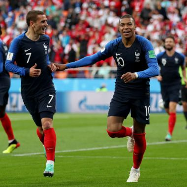 YEKATERINBURG, RUSSIA - JUNE 21: Kylian Mbappe of France celebrates with teammate Antoine Griezmann after scoring his team's first goal during the 2018 FIFA World Cup Russia group C match between France and Peru at Ekaterinburg Arena on June 21, 2018 in Yekaterinburg, Russia.