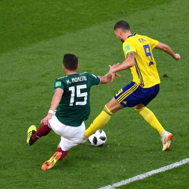 YEKATERINBURG, RUSSIA - JUNE 27: Hector Moreno of Mexico fouls Marcus Berg of Sweden inside the box to concede a penalty during the 2018 FIFA World Cup Russia group F match between Mexico and Sweden at Ekaterinburg Arena on June 27, 2018 in Yekaterinburg, Russia.