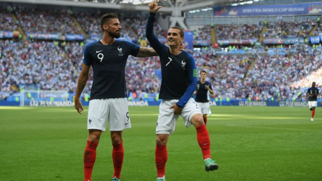 KAZAN, RUSSIA - JUNE 30: Antoine Griezmann of France celebrates with teammate Olivier Giroud after scoring his team's first goal during the 2018 FIFA World Cup Russia Round of 16 match between France and Argentina at Kazan Arena on June 30, 2018 in Kazan, Russia. (