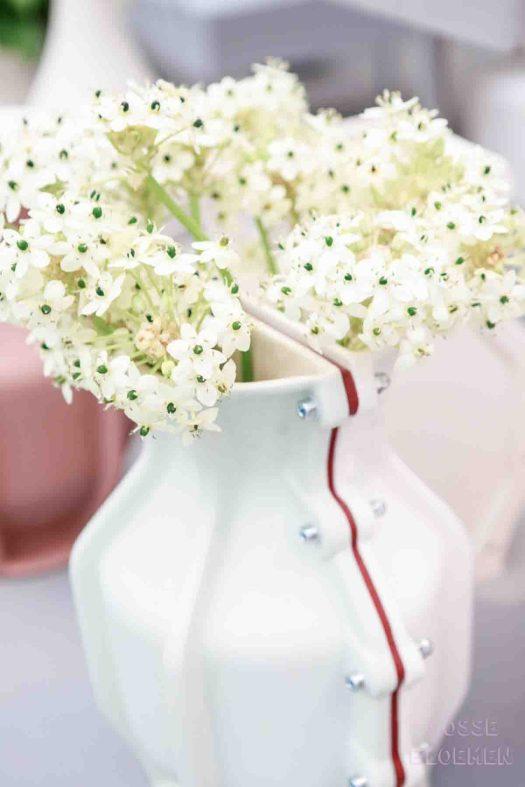 Cor unum vaas showup met losse bloemen