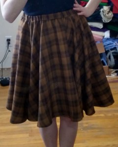 A brown plaid skirt, with an elastic waist and lots of volume at the hem.
