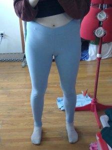 A pair of light blue stretch pants, similar to leggings or yoga pants.