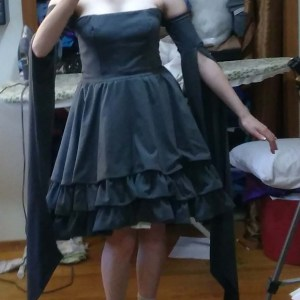A close up selfie of Jester's grey underdress - strapless, with long sleeves and a three tiered skirt.