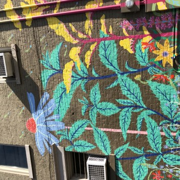 Flower Mural on the Side of Red Tree
