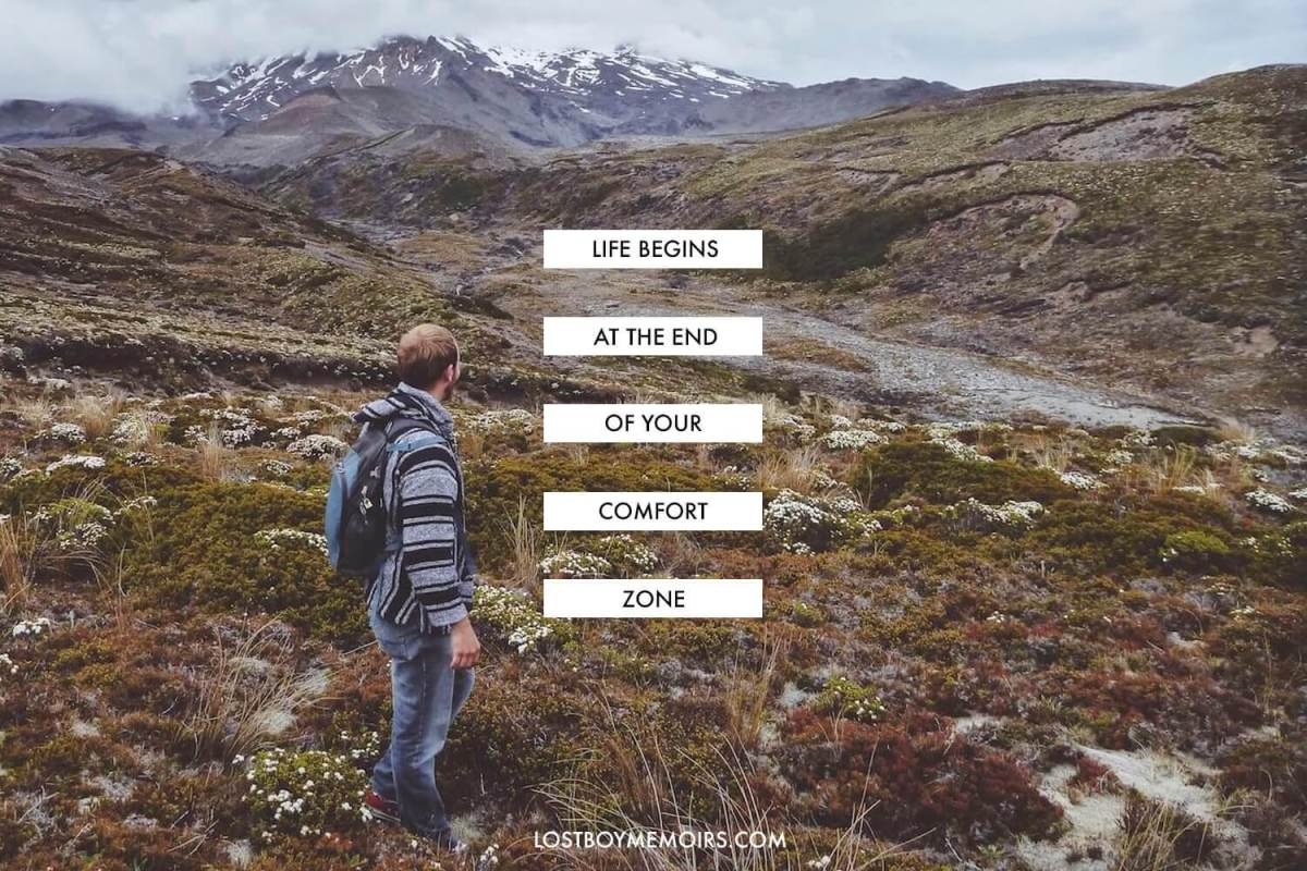 Inspirational Travel Quotes Life begins at the end of your comfort zone with a photo of a man standing before mountains in New Zealand.