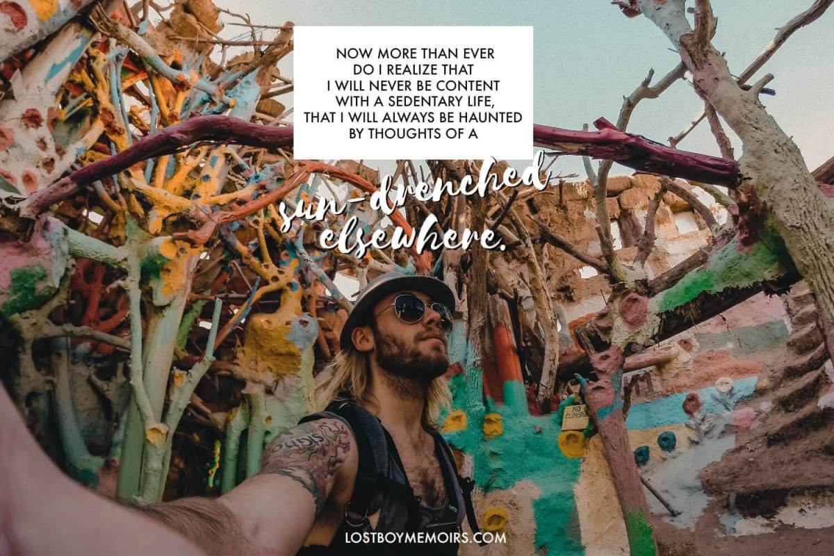 31 Inspirational Travel Quotes Graphic with a man inside of Salvation Mountain in California and the colorful trees.