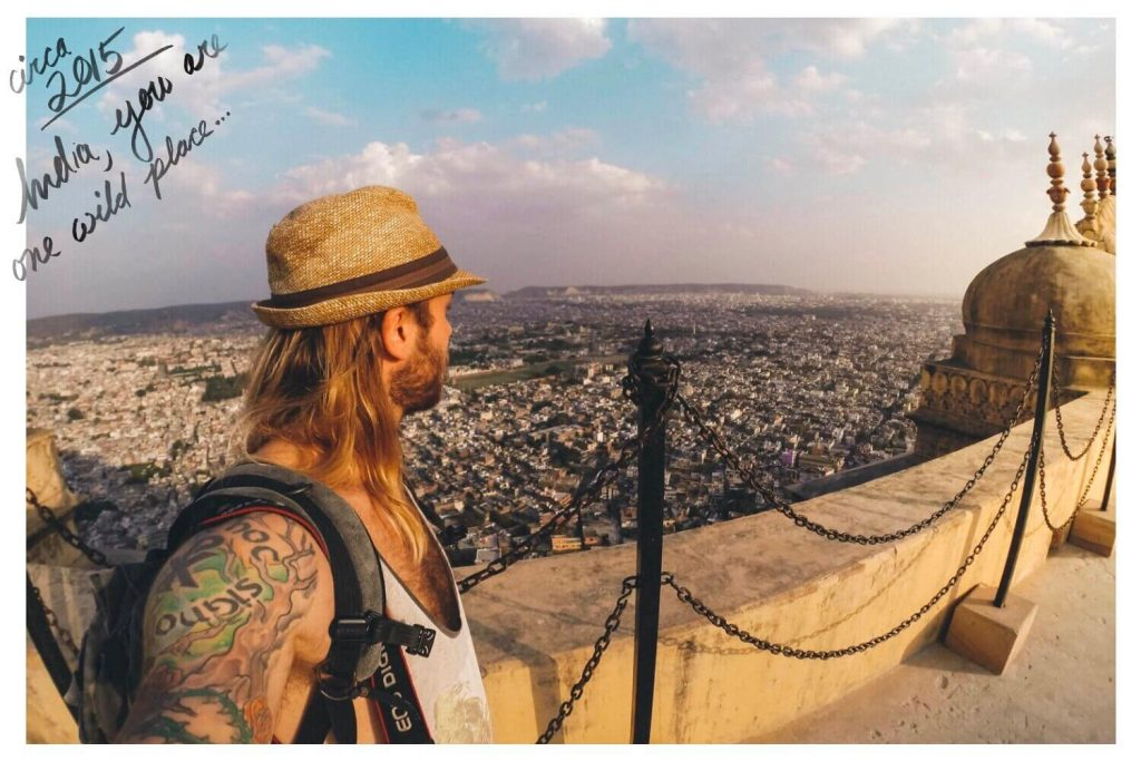 About Ryan Brown and Lost Boy Memoirs Travel Blog photo of Ryan on the walls of Agra Fort in India overlooking the city at sunset.