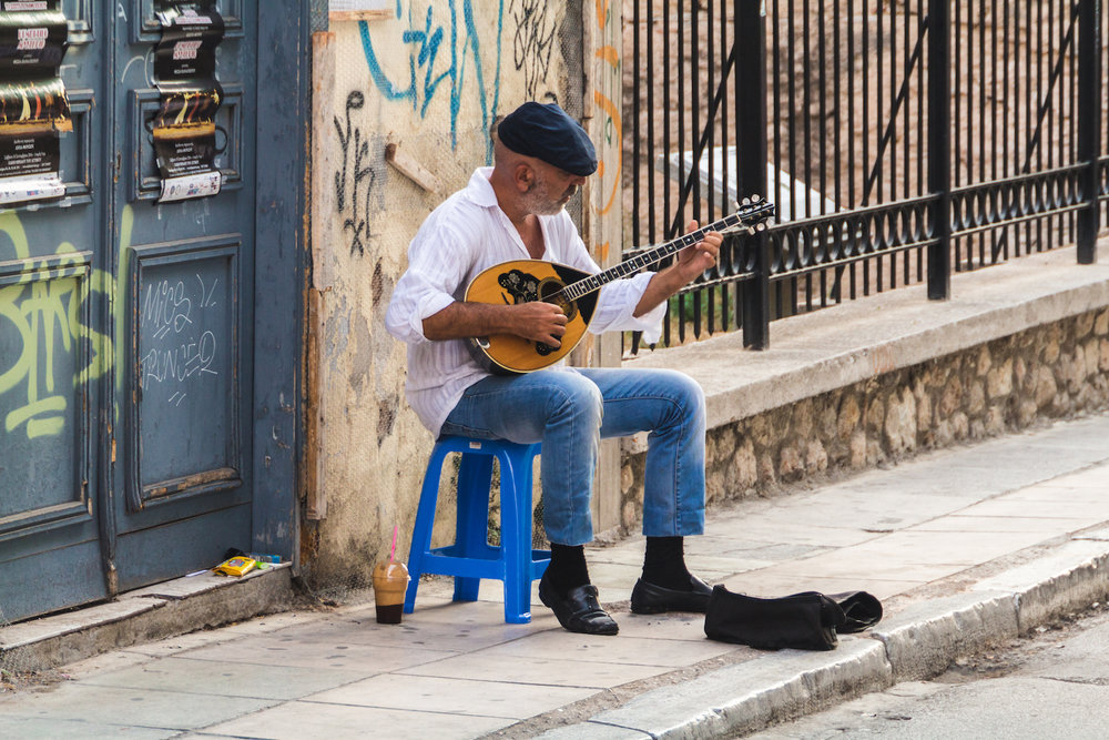 Photo of street musician while lost in Athens Greece.