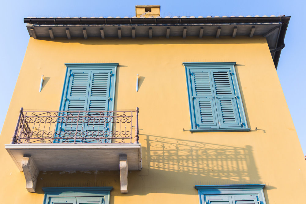 Photo of colorful yellow and blue apartment in Athens Greece.