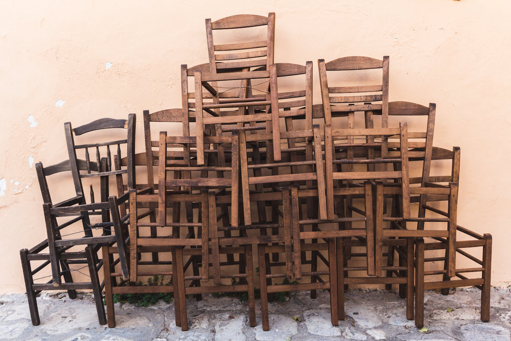 Photo of stacked chairs while lost in Athens Greece.