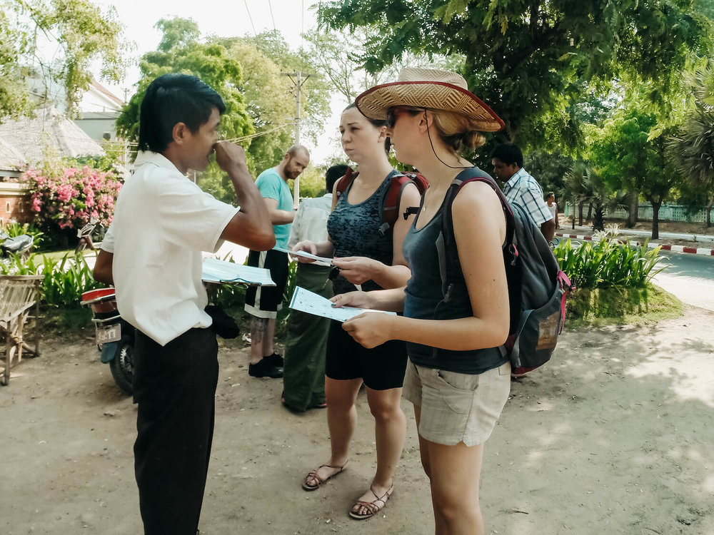 Photo of Jean of Traveling Honeybird asking for directions from a local in Bagan Myanmar.