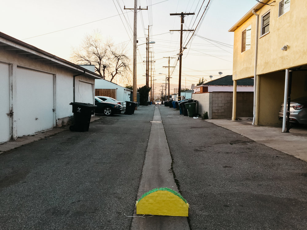 Lost in Los Angeles Photo Series. Photo of a taco Piñata in the middle of an alleyway in Los Angeles.