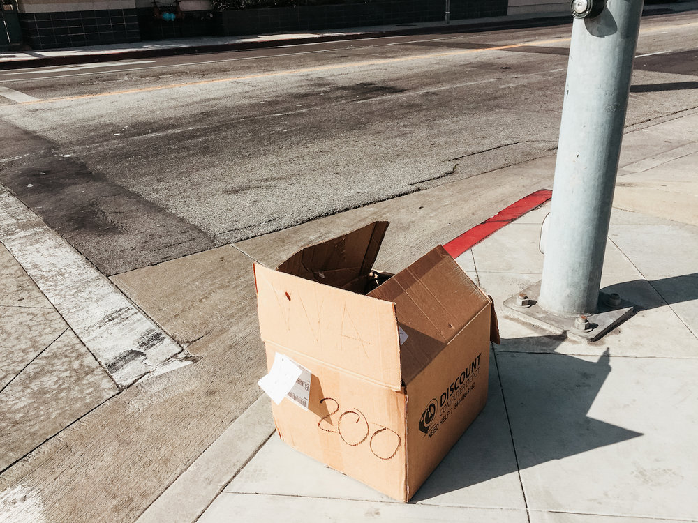 Lost in Los Angeles Photo Series. Photo of a cardboard box on the side of a road in Los Angeles.