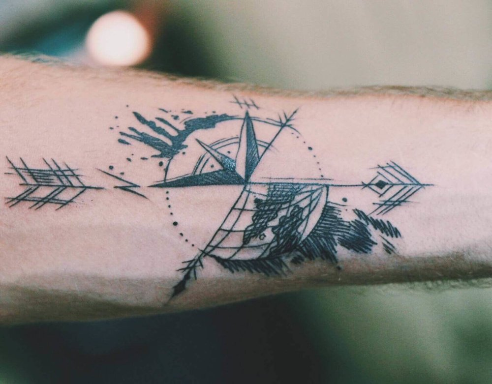 Hand drawn compass and globe arrow travel tattoo
