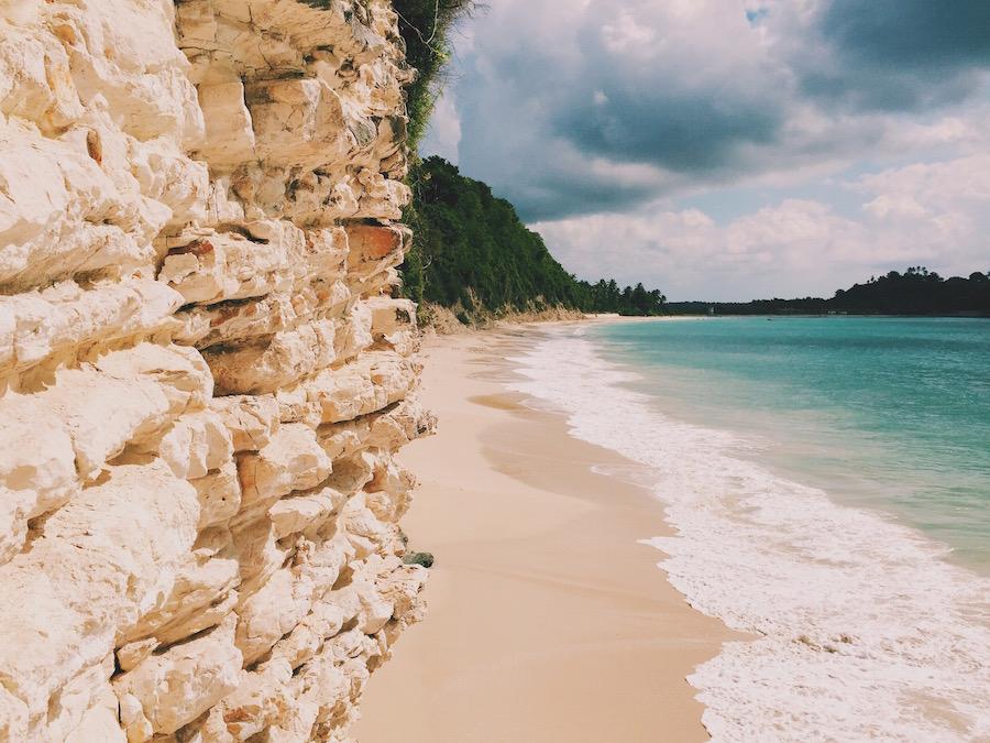 White sandstone cliffs and the beach on Ile A Vache island in Haiti.