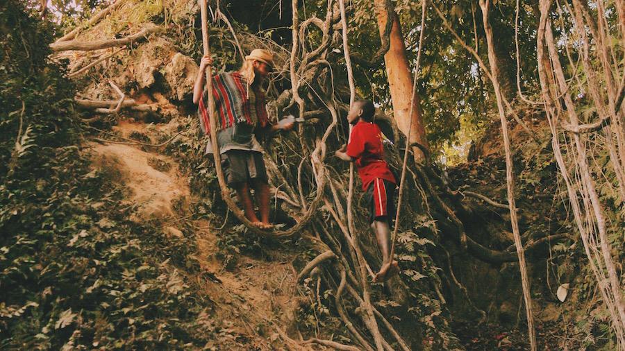A Haitian boy swings on vines and speaks with Ryan in Saut D'Eau near Port Au Prince, Haiti.